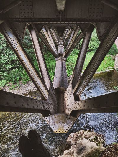 Bridge climbing Arch Architectural Column Architecture Below Beneath Bridge Bridge - Man Made Structure Day Engineering Famous Place Feet History Iron - Metal Low Section Mettal Outdoors Person Personal Perspective River Rustic Tourism Travel Destinations Under Water