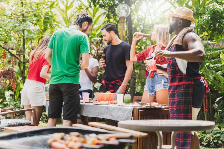Group of people having food in yard