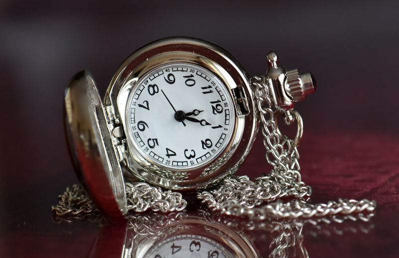 Indoors  Table Watch Still Life Time Clock Studio Shot No People Pocket Watch Antique Metal Close-up Silver Colored Wealth Jewelry Number Retro Styled Instrument Of Time Luxury Personal Accessory Ornate