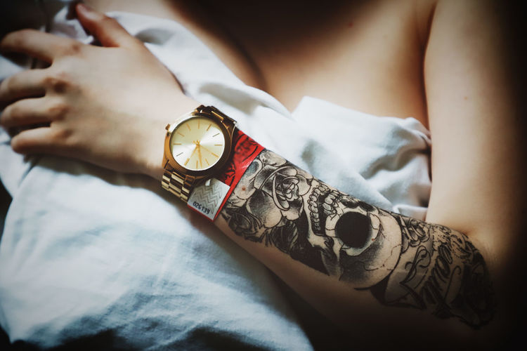 Tattoo Tattoos Watch Ribbon Human Body Part Skin Woman Women Hand Human Hand Human Representation Indoors  Real People One Person Close-up Body Part Lifestyles Time High Angle View Limb Midsection Selective Focus Personal Perspective Human Limb Leisure Activity Human Arm Finger International Women's Day 2019
