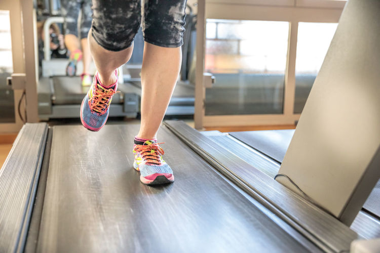 Close up of woman legs in colorful shoes running on treadmill machine in gym. Fast training indoor. Healthy active lifestyle concept. Woman Gym Exercising Females Girl Running Bicips Tapis Roulant Athlete Sport Press Machine Training Trainer Triceps Legs Lifestyles Healthy Biceps Muscles Indoors  Indoors  Healthy Lifestyle Human Leg Low Section Human Body Part Sports Training Women Sports Clothing Body Part Wellbeing Shoe Leisure Activity Exercise Equipment Treadmill Real People Human Limb Exercise Machine Self Improvement