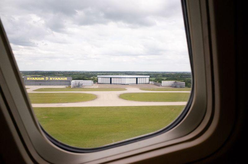 Scenic view of landscape seen through train window