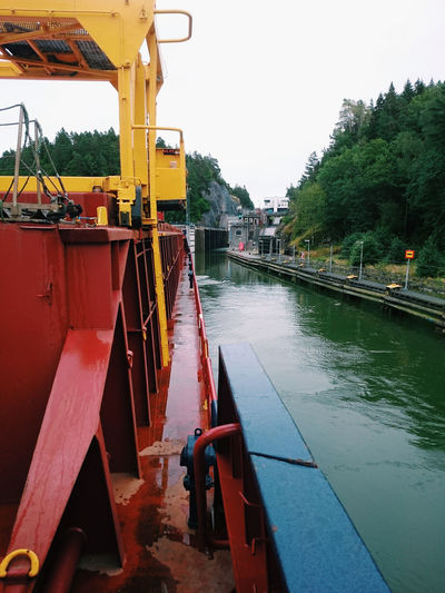 Getting to the penstock with a cargo vessel. Blue Color Canal Cargo Ship Cargo Vessel Channel Green Color Lock Marine Industry Marine Transportation Nature Nautical Vessel No People Outdoors Penstock Red Color River Ship Sluice Sweden Vessel Water White Sky Yellow Color