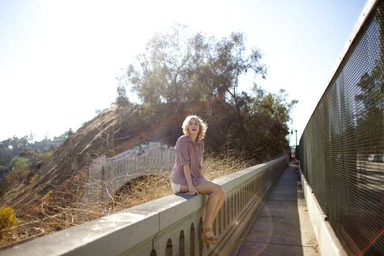 Full length of woman standing by railing