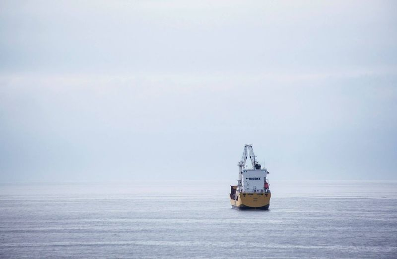 Tugboat On Sea Against Sky