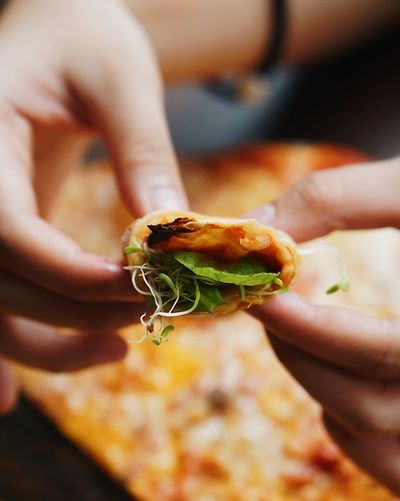 Cropped Image Of Hands Holding Food