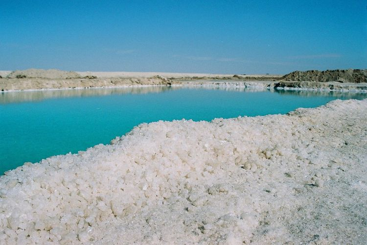 Film Beauty In Nature Blue Clean Clear Sky Copy Space Day Hot Spring Idyllic Lagoon Land Mineral Nature No People Non-urban Scene Power In Nature Salt - Mineral Salt Flat Scenics - Nature Sea Sky Tranquil Scene Tranquility Turquoise Colored Water