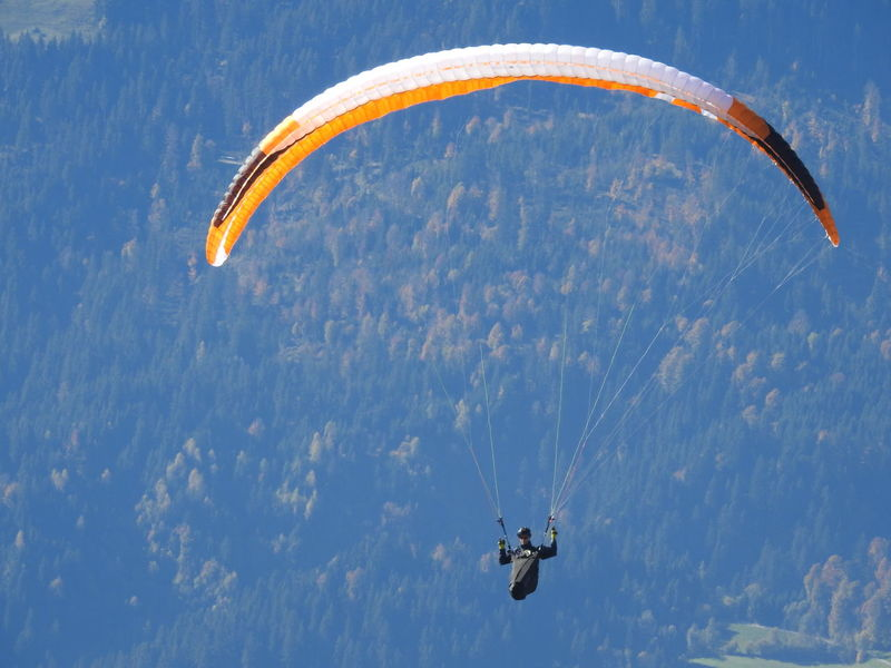 Adventure Day Excitement Exhilaration Extreme Sports Flying Freedom Fun Gliding Leisure Activity Low Angle View Mid-air Nature One Person Outdoors Parachute Paragliding People Real People RISK Sky Skydiving Sport Stunt Person Vacations Go Higher