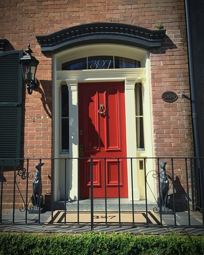 Every decision has a deeper message. A brass door knob and knocker, the detail of the crown molding, a custom welcome-mat, the symmetry of a statue on either side, the curved stylistic numbers on the window, but most of all, the Red door. The Red Door Urban Landscape Old Brick Houses Entrence
