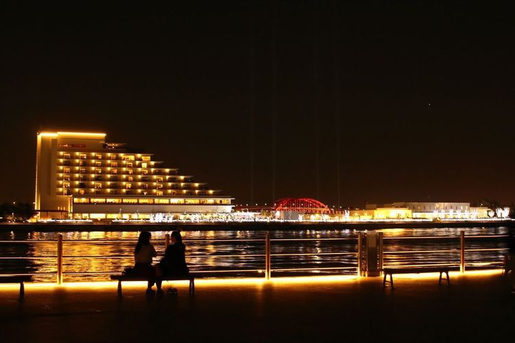 2 Girls By The Sea Night View Architecture Built Structure Building Exterior Night Illuminated City Sky Real People