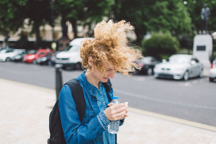 Curly Hair Day Girl Hair In The Wind Walking Water Bottle  Windy Young Woman Connected By Travel Postcode Postcards #urbanana: The Urban Playground