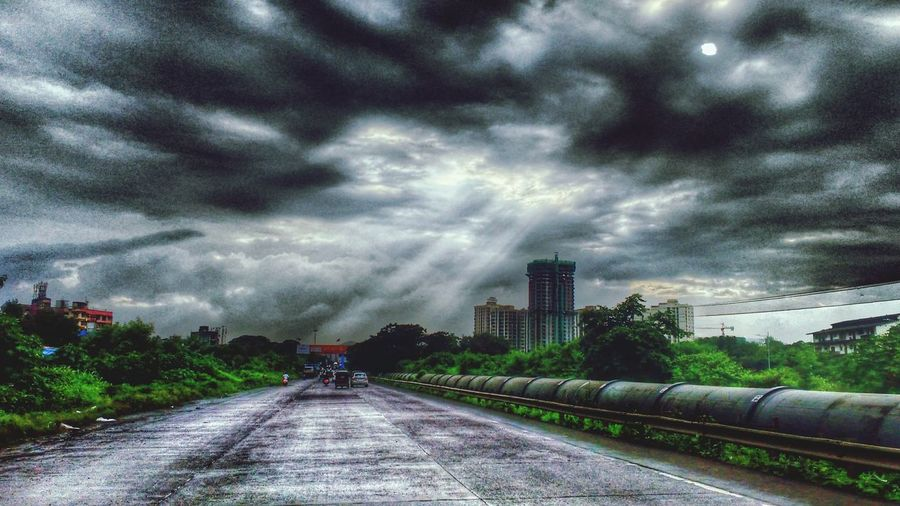 Cloudy The Way Forward Transportation Cloud - Sky Diminishing Perspective Sky Road Tree Storm Cloud Overcast Water Day Vanishing Point Sunbeam Outdoors Dramatic Sky Cloudscape Development City Life Long