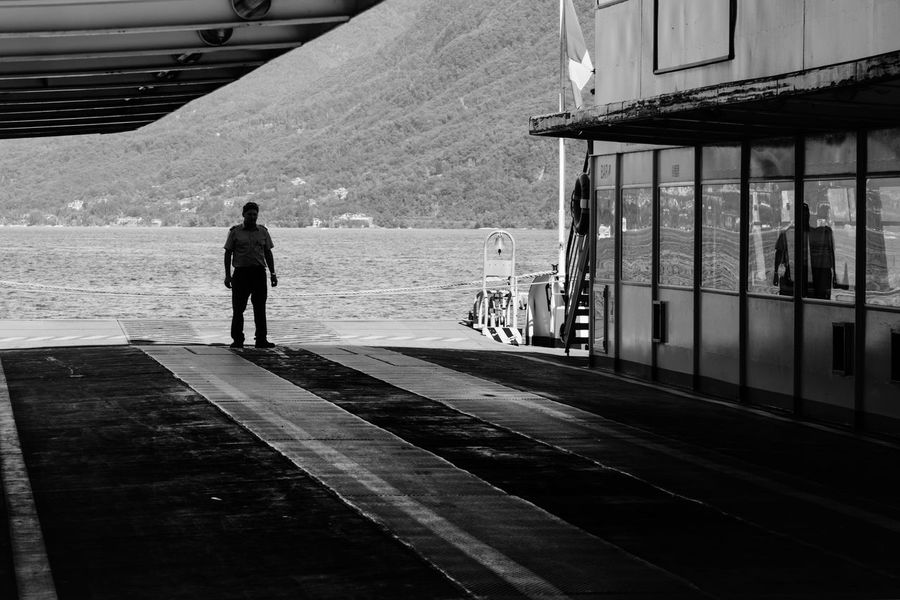 ok Ferry Policeman Silhouette Twilight Waiting Adult Architecture Building Exterior Built Structure Control Day Dock Full Length Lake Men Mountain One Man Only One Person Outdoors People Police Real People Rear View Standing Transportation