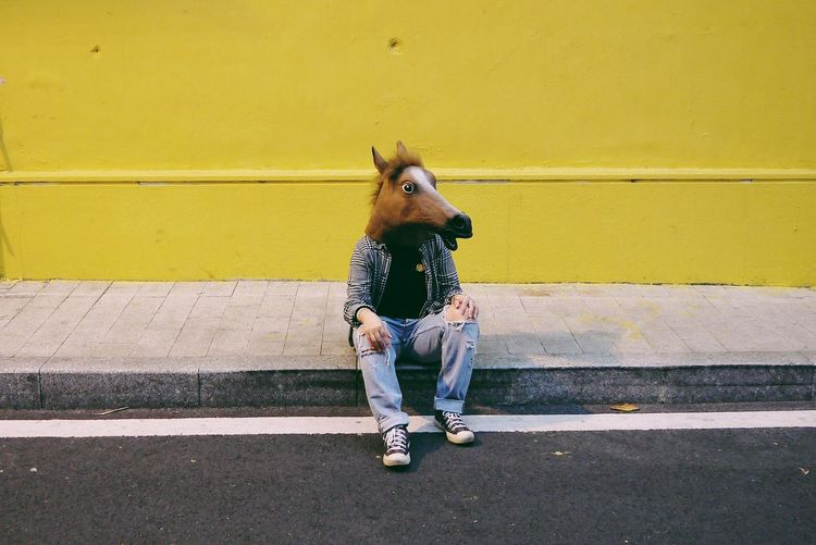Sitting Horse Face Yellow One Person Front View Casual Clothing Outdoors Childhood Full Length Leisure Activity Fashion Lifestyles The Portraitist - 2018 EyeEm Awards