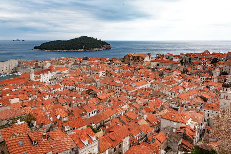 Looking out and onto Dubrovnik, Croatia on a cloudy day Croatia Architecture Building Exterior Built Structure Cityscape Cloud - Sky Day Dubrovnik High Angle View Horizon Horizon Over Water House No People Outdoors Roof Scenics Sea Sky Tiled Roof  Travel Destinations Water