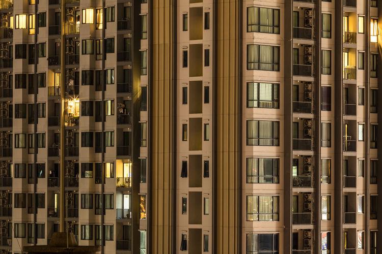 Full frame shot of modern building at night