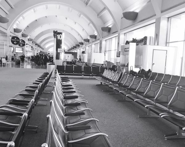 Waiting time Airport In A Row Large Group Of Objects Indoors  Chair Architecture No People Exit Sign Day Travel Destinations Chairs Perspective Lined Up In A Row Empty Places Airport Waiting Transportation Travel Photography