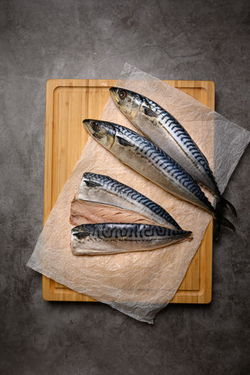 High angle view of fish on wooden plate