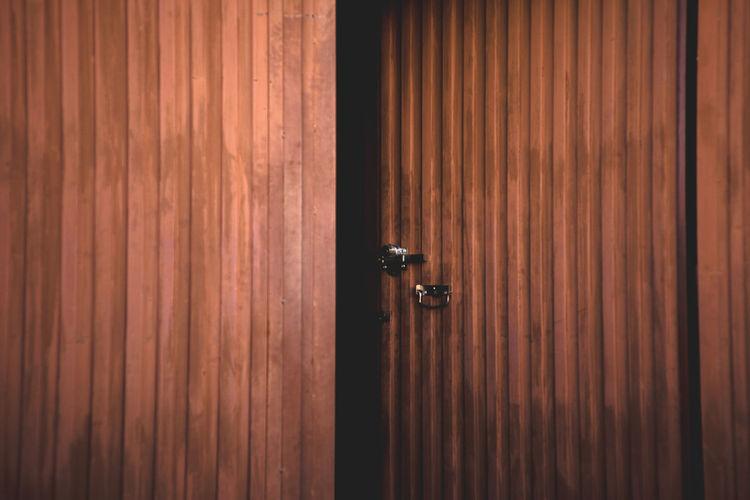 Full Frame Shot Of Open Wooden Door