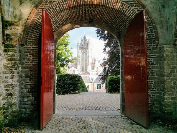 View of Peterskerk from the Burcht van Leiden. arch Architecture built structure no people old buildings Castle keep Cathedral Church Framing framing the view fantasy Magical red doors Open doors white burcht leiden Burcht van Leiden castle of Leiden Leiden peterskerk old Arch Architecture Built Structure No People Old Buildings Castle Keep  Cathedral Church Framing Framing The View Fantasy Magical Red Doors Open Doors  White Burcht Leiden Burcht Van Leiden Castle Of Leiden Leiden Peterskerk Old Church Of St Peter Shell Keep Netherlands EyeEm Ready