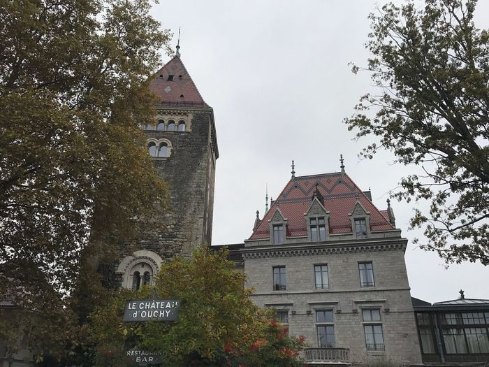 Le Château D'ouchy Lausanne Castle Architecture Building Exterior Built Structure Low Angle View Religion Tree Place Of Worship No People Spirituality Sky Outdoors Day Bell Tower