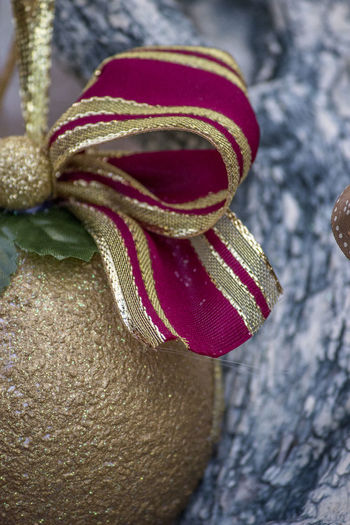 Christmas Decoration Christmas Ribbon Christmas Tree Decoration Close-up Day Focus On Foreground Gold No People Outdoors Red