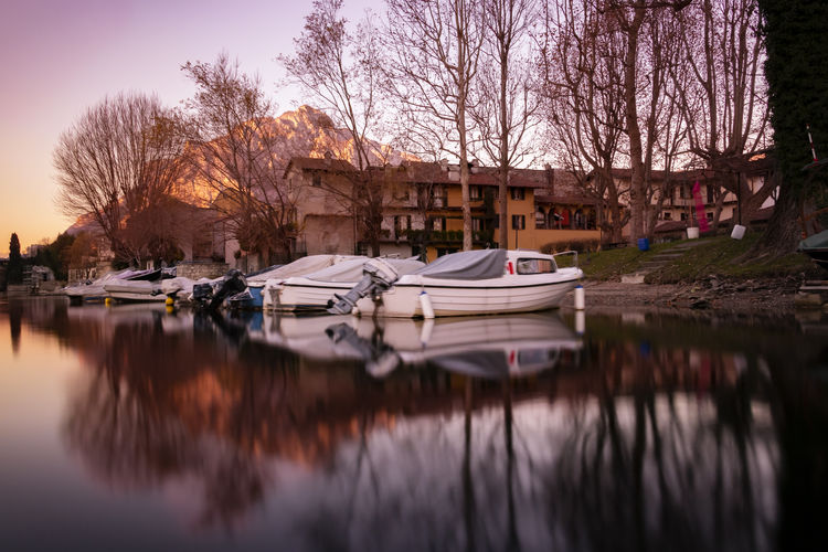 Pescarenico MR7 Eos77D EyeEm Selects EyeEm Best Shots Mountain Photography Lombardia adventures in the city Adventure Moments Canon Lecco Water Nautical Vessel Tree Lake Moored Reflection Sky Reflecting Pool Boat Standing Water Waterfront Wake - Water Canal Lakeshore Calm Moving