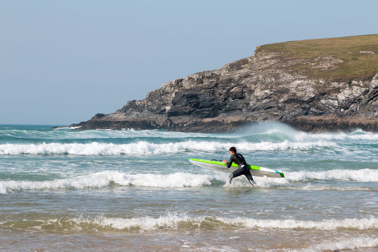 Surfs up at Holywell Bay, Cornwall Cornwall Beach Surf Surf's Up Aquatic Sport Beauty In Nature Clear Sky Cornwall Cornwall Uk Horizon Over Water Land Leisure Activity Lifestyles Motion Nature Ocean One Person Outdoors Real People Sea Sky Sport Surf Photography Surfing Water Wave