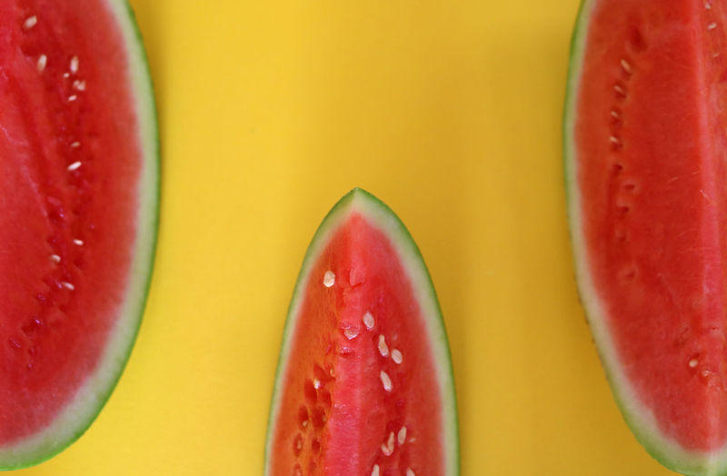 Abstract Pattern of real slices of watermelon on bright, colorful, yellow background Abstract Art Close-up Color Color Clash Design Food Food And Drink Food Photography Freshness Fruit Group Of Objects Healthy Eating Indoors  Juicy No People Pattern Red Ripe SLICE Still Life Studio Shot Texture Watermelon Yellow