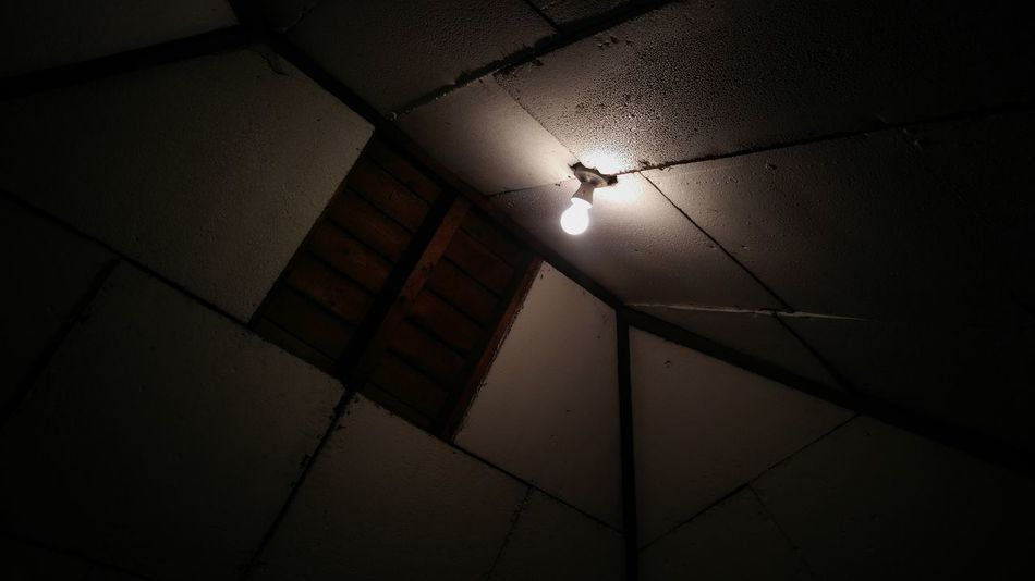 Scary attic loft picture with a single light brightning the dark creepy room Dark Night Shadow No People Indoors  Crime Scene Scary Alone Creepy Kidnapping Kidnapped Scary Moment Light Light And Shadow Darkness Isolation
