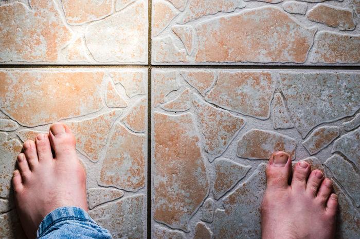 Extremities Feet Floor Flooring Foot Human Body Part Jeans Man Nails Toenails No Socks Tiles Toes Kitchen Decor Floor Tiles Cracks Pattern From Above  Horizontal Off Centre Denim Blue Denim