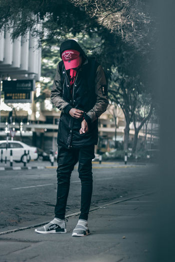 Street fashion Africa Fresh On Eyeem  EyeEm Best Shots Teenager EyeEm Standing Fresh On EyeEm 2018 Shoe Streetphotography Men Males  Adult Winter People Fashion Human Body Part Outdoors Portrait One Person Day City Young Adult One Man Only Stories From The City