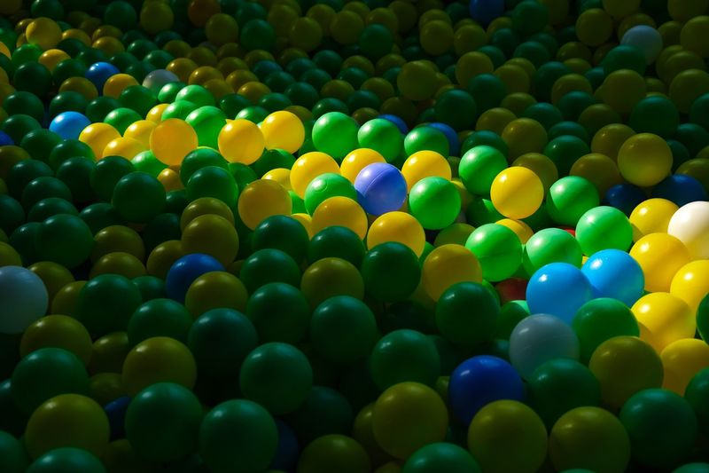Sunlight on the play balls Sunlight Multi Colored Large Group Of Objects No People Backgrounds Indoors  Ball Sphere Still Life Green Color Variation Repetition Shape Enjoyment Pattern High Angle View
