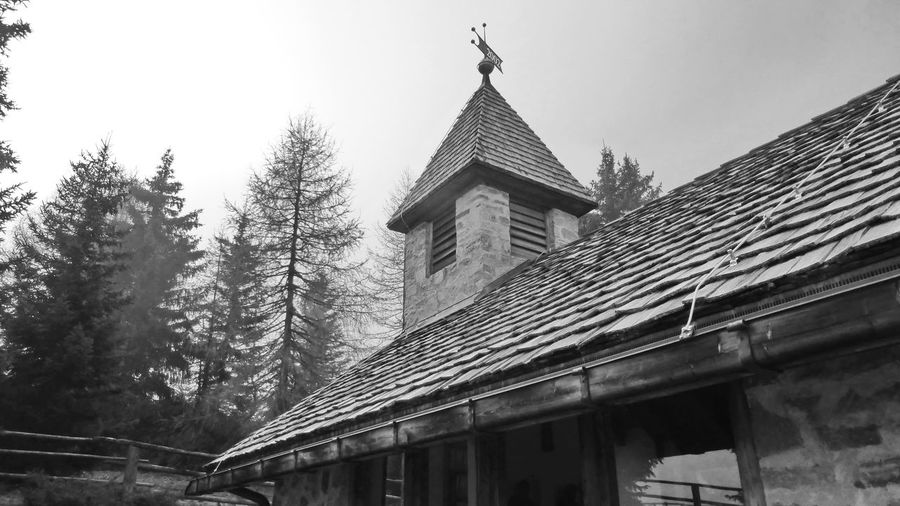 Mountain Chapel Chapel Church Architecture Belief Blackandwhite Photography Building Building Exterior Built Structure Clear Sky Day Low Angle View Nature No People Outdoors Place Of Worship Plant Religion Roof Sky Spirituality Tree