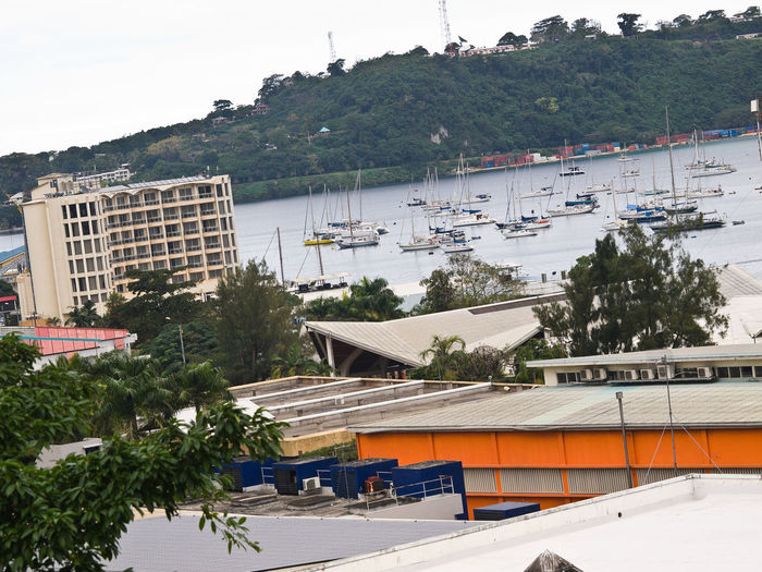 Downtown Port Vila Harbour Architecture Building Exterior Built Structure Cyclones Day Growth Harbor Harbour View High Angle View Iririki Island Melanesian Mountain Mountain Range Pacific Pacific Ocean Plant Port Vila Harbour Vanuatu. Resort Roof Sky Travel Destinations Tree View Of The City Vivid International Water