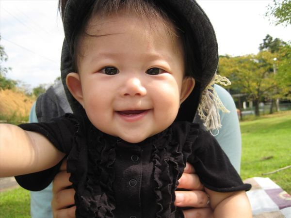 Portrait Looking At Camera Baby Smiling Childhood Happiness Cute Cheerful People Human Body Part Outdoors Human Face One Person Child Day Selfie Close-up Protruding Babies Only Adult