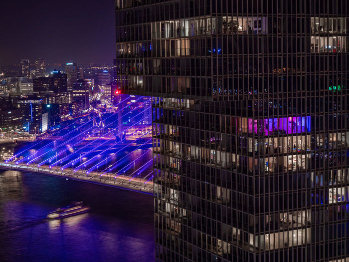 Illuminated Night Architecture City Building Exterior Built Structure Cityscape Building No People Outdoors Nature Transportation Travel Destinations Water Office Business High Angle View City Life Skyscraper Office Building Exterior Purple Nightlife