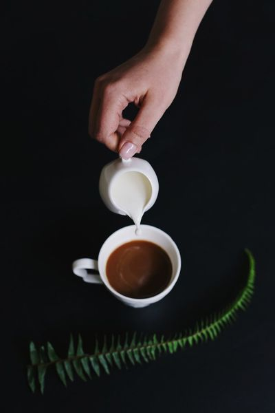 Coffee with milk Milk Human Hand Food And Drink Hand Human Body Part Cup Drink Coffee Mug Coffee Cup Table Unrecognizable Person Coffee - Drink Holding Indoors  One Person