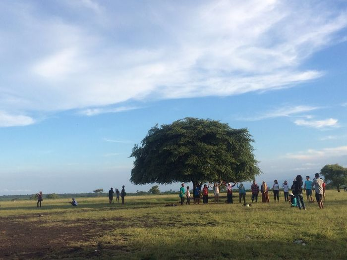 People enjoying at baluran national park against sky