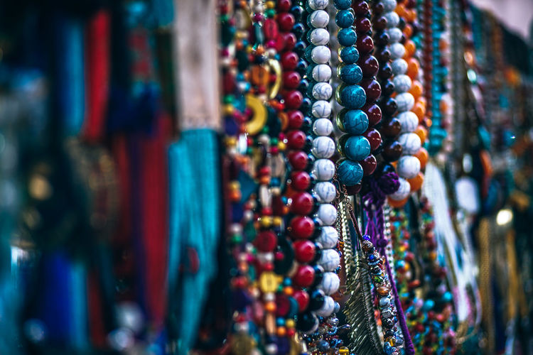 Close-up of multi colored jewelry at market stall