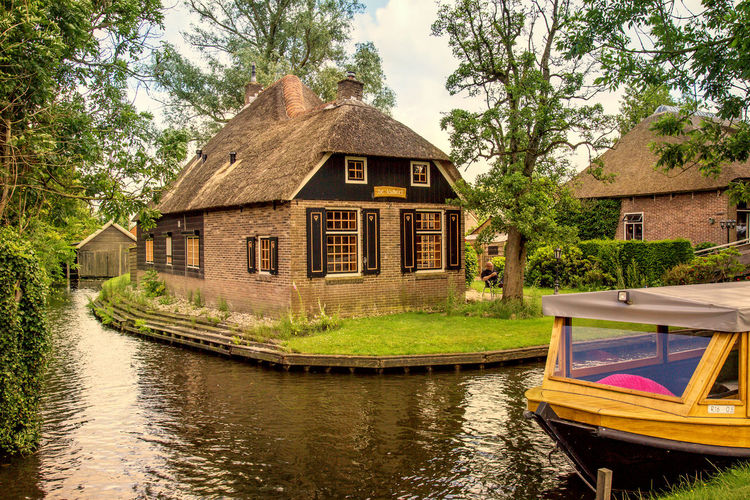 Boat Calm Canal Chilling Giethoorn Green Color Holiday Holland Hut Nature Nederland Outdoors Relax Sky Tourism Tourist Attraction  Tree Village Water Waterfront