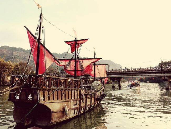 Old Schooner in Danxia, China Tourists Bridge Over Water Charming Place Tourismus Wooden Boat Overcast Skies Vintage Style Tourist Attraction  Nostalgia Chinatrip Danxia Sailing Ship Schooner Nautical Vessel River Outdoors Water Transportation Day Waterfront Moored Tall Ship The Traveler - 2018 EyeEm Awards