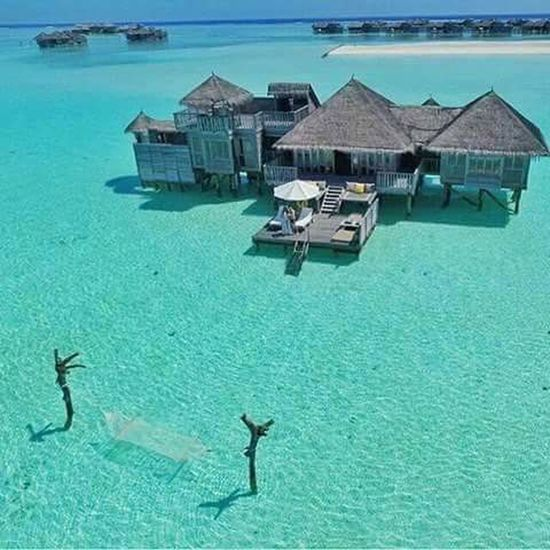Beach High Angle View Water Sea Stilt House Tourist Resort Tropical Climate Travel Architecture Luxury Floating On Water Adult Outdoors Nature Beach Day Nautical Vessel People Beauty In Nature Adults Only
