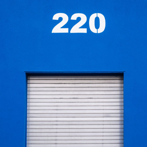 Architecture Built Structure No People Day Outdoors Blue Communication Sign Number Building Exterior Wall - Building Feature White Color Building Information Copy Space Corrugated Information Sign
