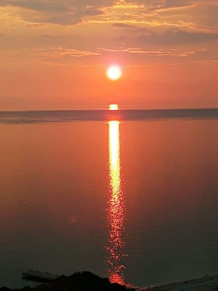 sunset over the sea Travel Destinations Tourism Water Sea Sunset Beach Red Sun Sunlight Awe Reflection Accidents And Disasters Romantic Sky Salt Basin Reflection Lake Dramatic Sky Idyllic Sky Only Atmospheric Mood Majestic Seascape Salt Flat Dramatic Landscape