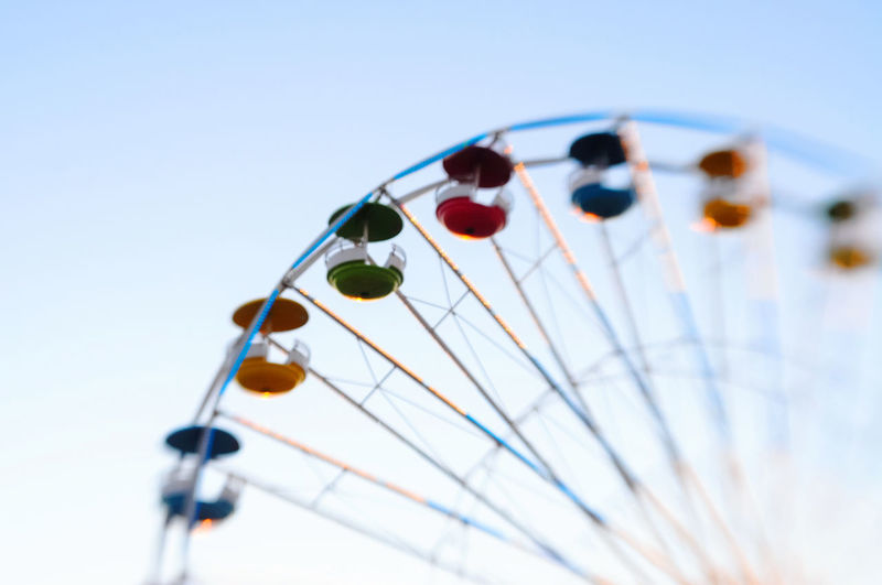 Close-up of ferris wheel against sky