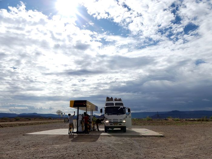 EyeEmNewHere Cloud - Sky Day Friendship Gaz Station Land Vehicle Men Mode Of Transport Nature Outdoors People Real People Road Sky Sunlight Transportation