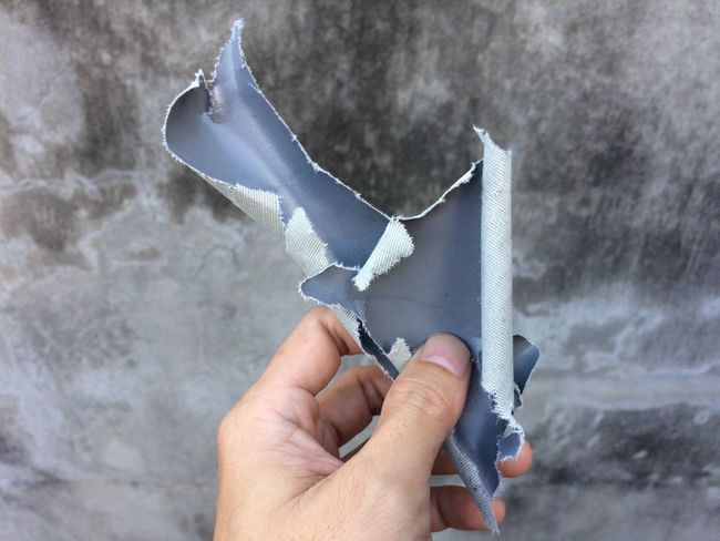 Close-up Cutting Day Destruction Duct Tape Holding Human Body Part Human Hand One Person Outdoors Paint Roller People