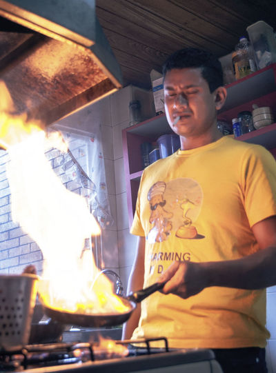 Man working on barbecue grill at restaurant
