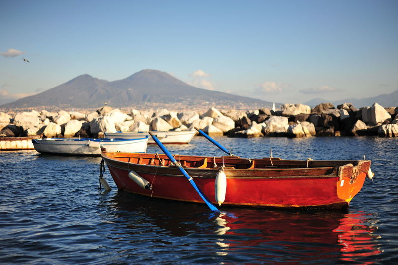 Boat on shore against sky